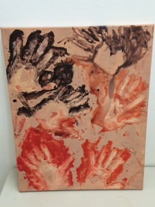 My attempt at making negative hand prints. I painted a sandy colour as a background to try and copy the typical colour of cave walls. I used a orangey red and a darker colour to try and keep it authentic.